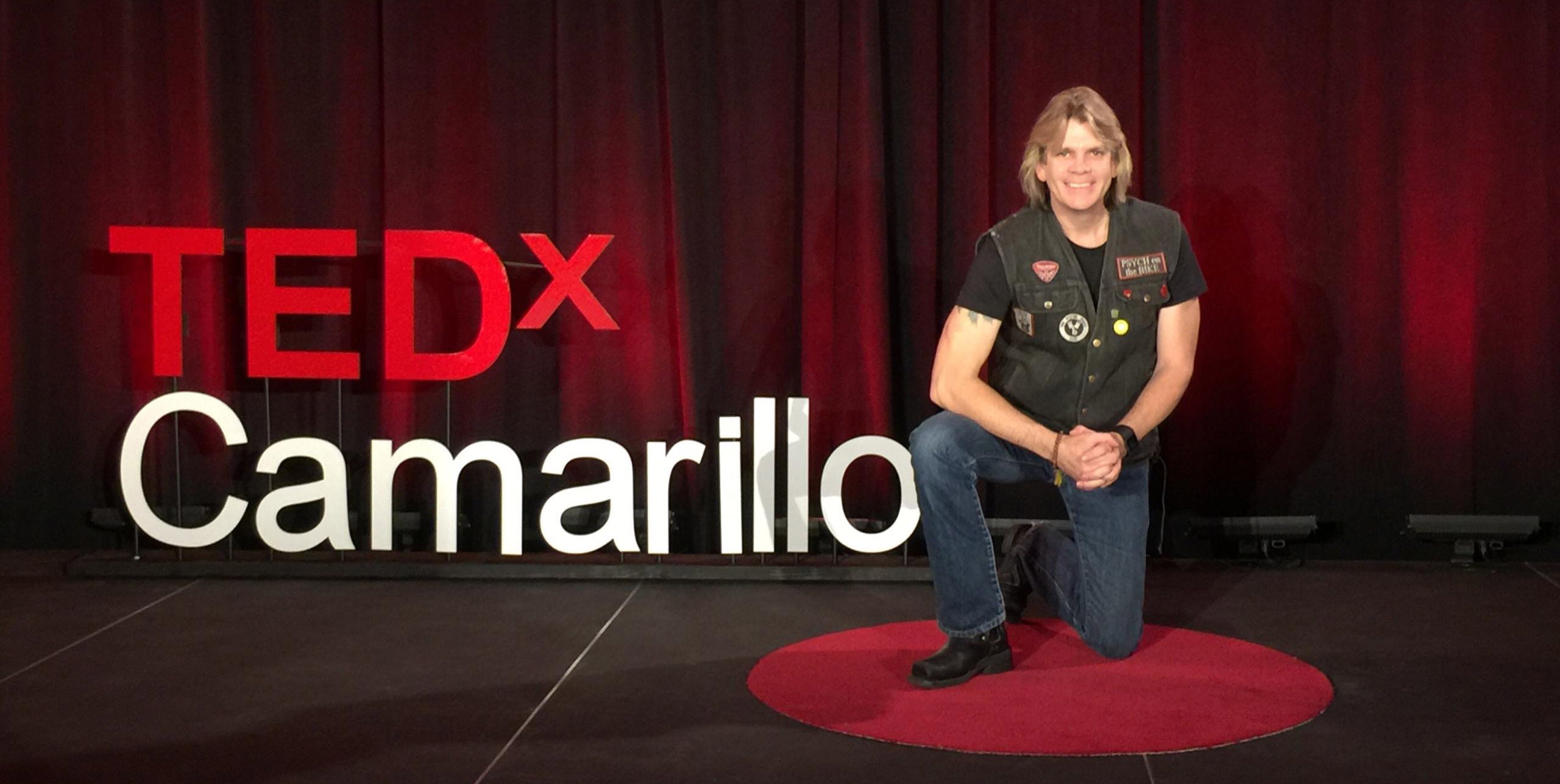 Dr. Stephen Trudeau's cover photo during TEDxCamarillo speech, teaching humans how to thrive